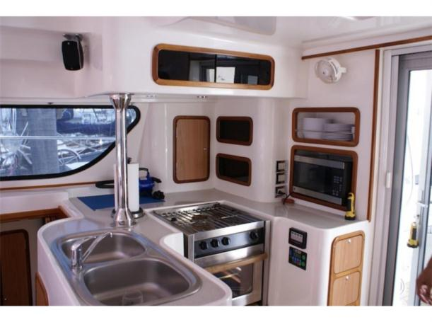 Preowned Power Catamarans for Sale 2006 Africat 420 Galley
